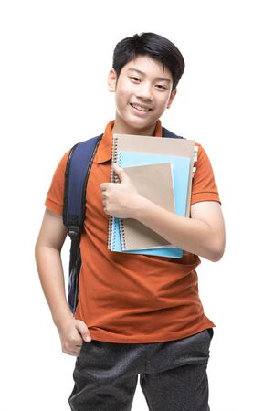 Cute asian child with school stationery on white background . Back to school concept. Banque d'images - 132044857