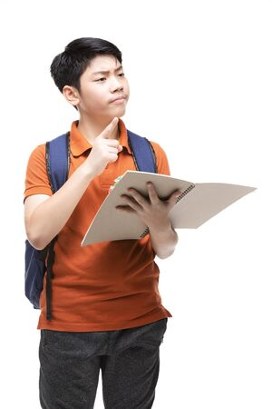 Cute asian child with school stationery on white background . Back to school concept. Banque d'images - 132044933
