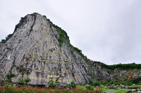 stone age: The sculpture of Buddha Image on the cliff Stock Photo