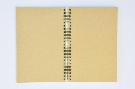 ring binder: Spiral black recycle notebook open on white desk