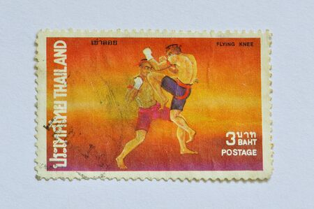 THAILAND - CIRCA 1975: A stamp printed in Thailand,  Flying Knee, one of Thai Boxing Set, circa 1975  photo