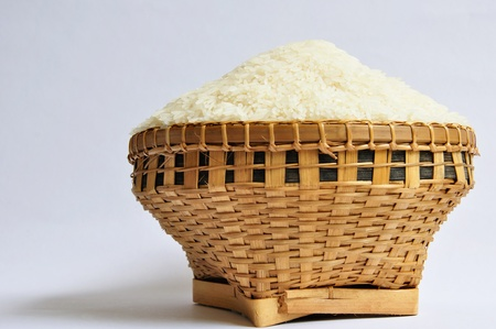 Raw rice with weaving basket
