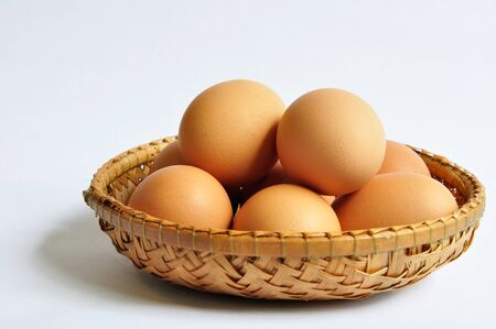 Egg in the weaving basket photo