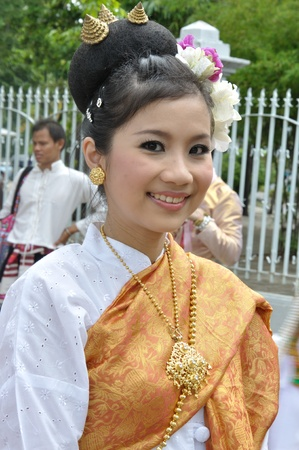 BANGKOK, THAILAND - OCTOBER 3: Thai lady in traditional dress in the parade of making traditional merit of people from the northern territory of Thailand, October 3, 2010 in Bangkok, Thailand.  Stock Photo - 10207878