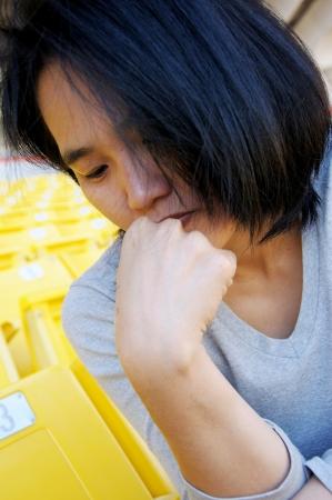 Closeup portrait of a young Asian sad girl photo