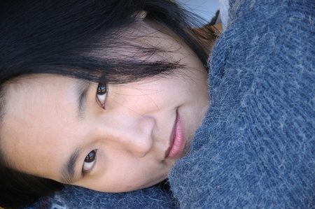 Close up of Asian woman lying down photo