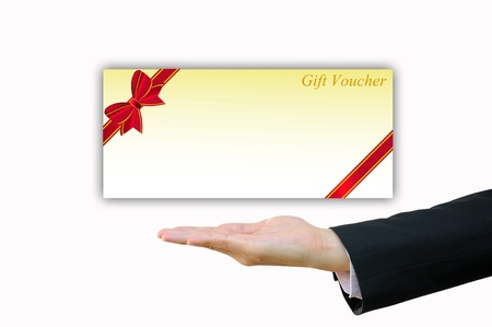 free holiday background: Business hand with gift voucher