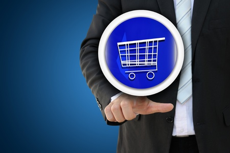 e commerce: Businessman pointing cart for E Commerce concept Stock Photo