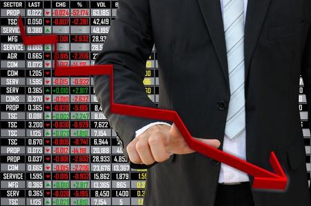 Business man met afnemende beurs grafiek