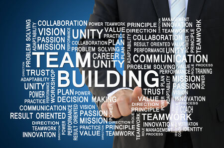 building plans: Businessman pointing team building for teamwork and business concept