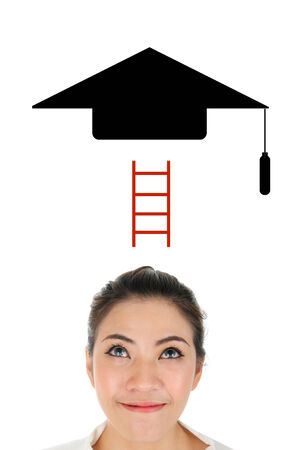 look up: Young woman look up bachelor hat for successful in education concept