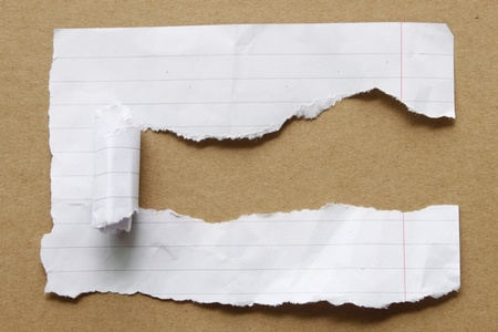 teared paper: Ripped paper on brown background