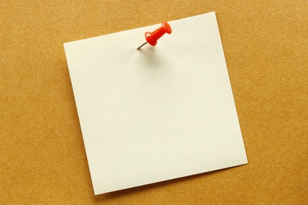 Blank orange post-it note  on brow background Stock Photo - 10137037
