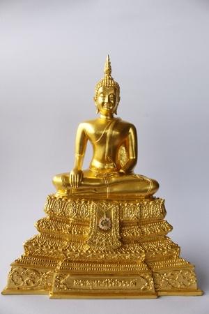 Gold image of buddha isolate on the white. photo