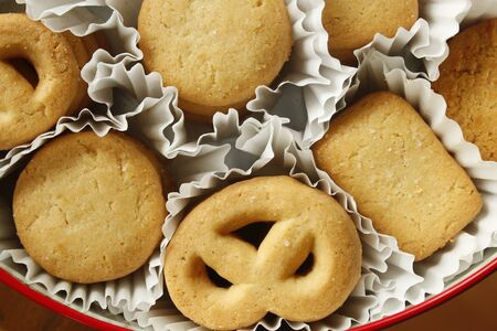Overhead view of the cookies in a circle shaped container over light gray background photo