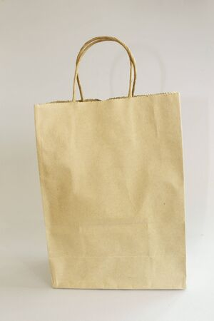 recyclable paper bag isolated on white background. photo