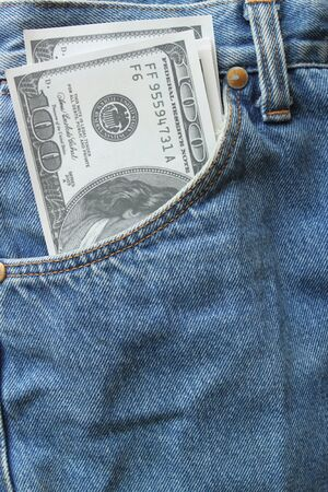 money in front-pocket of jeans Stock Photo