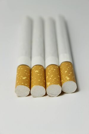 Smoking cigarettes isolated on the white background photo