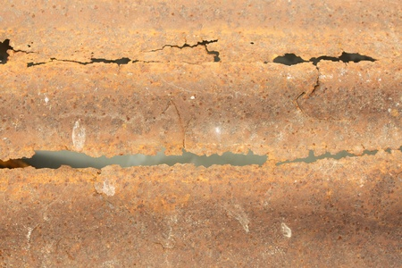 Pattern of a rough surface of rusty metal with jagged edges on black background