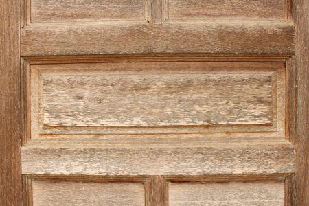 sordid: Old dirty brown wooden door