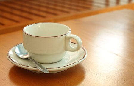 musetti: a cup coffee on wood brown background Stock Photo