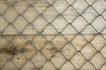 vintage mesh fence wood brown background photo
