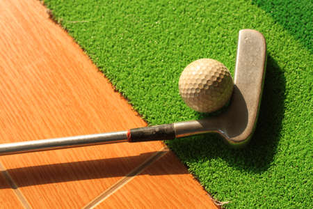 golf ball and old putter photo