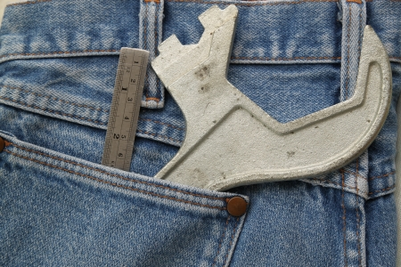 lug: Blue jeans pocket with chrome lug wrench