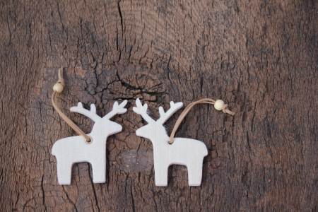 snow break: White elks on wood