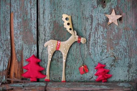 Christmas elk bringing gifts over vintage background 写真素材