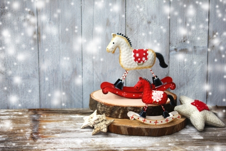 Rocking horse over wooden background   Vintage christmas card