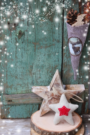 Christmas star over wooden background   Vintage christmas card
