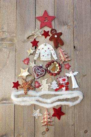 Christmas tree on wooden background photo