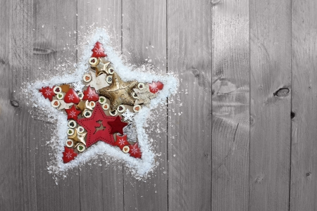 Christmas star over wooden background   Vintage christmas card photo