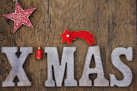 XMAS Christmas letter on wooden background photo