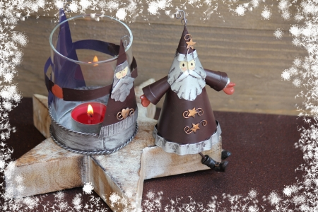 Santa Claus Christmas decoration with candle photo