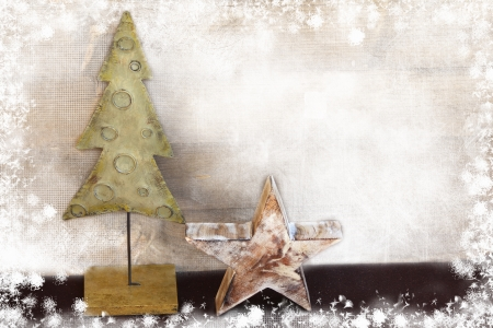 Christmas tree and star on wooden background