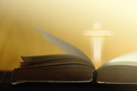 Bible and Cross in Golden Light