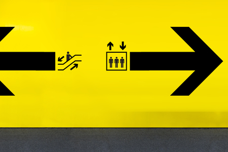 Airport Sign With Elevator Icon, Escalator and Arrow Stock Photo