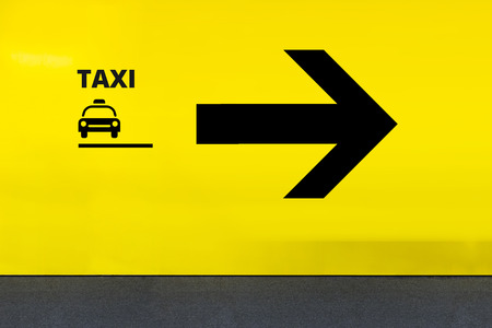 Airport Sign With Taxi Icon and Arrow