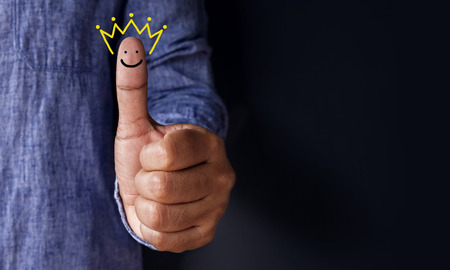 Customer Experience Concept, Best Excellent Services Rating for Satisfaction present by Thumb of Client with Crown and Smiley Face icon Stock fotó