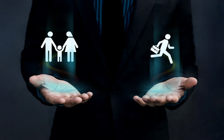 work life balance: Work Life Balance Concept, Shape of Family and Businessman Float over Careful Gesture Hand