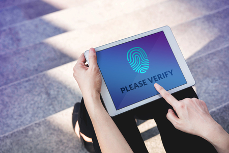 Verification Access for Security System Concept, Woman using Tablet with Fingerprint Scanning Technology in Outdoor Standard-Bild