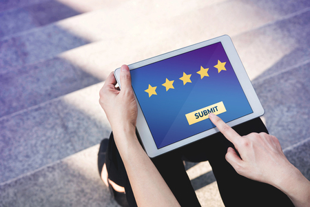 Customer Experience Concept, Best Excellent Services Rating for Satisfaction present by Hand of Client pressing Submit Button for Five Star on Digital Tablet