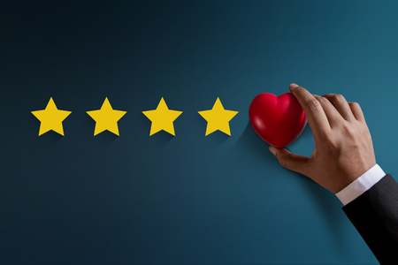 Customer Experience Concept, Best Excellent Services Rating for Satisfaction present by Hand of Happy Client put a Heart on Five Star Banco de Imagens - 88977891