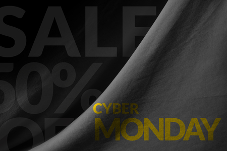 Cyber Monday Promotional Concept on Fabric background Stock Photo