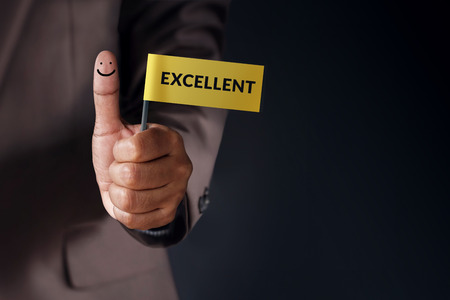 Customer Experience Concept, Best Excellent Services Rating for Satisfaction present by Thumb of Client with Excellent word and Smiley Face icon 스톡 콘텐츠