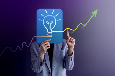 Ideas, Creativity and Innovation Concept. Woman Covered her Face, presenting a LightBulb and Body Language by Finger Up with Positive Graph Lines