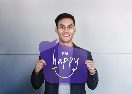 Happy Person Concept. Young Man Smiling and Show I am Happy Text on Speech Bubble Card. Positive Human Face Expression. Good Emotion