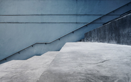 Empty Gray Concrete Staircase, Modern Cement Industrial Loft Style. Side View and Selective Focus, Interior or Exterior Design Concept